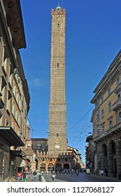 BOLOGNA, ITALY – JULY 17, 2017:  local and tourists in Rizzoli street with  the Asinelli tower in the bottom. One of the city typical street.