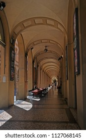BOLOGNA, ITALY – JULY 17, 2017:  tourist along the old medieval portico in Farini street. One of the city typical street.