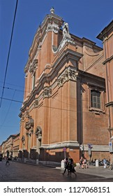 BOLOGNA, ITALY – JULY 17, 2017:  antique saint Peter cathedral in Indipendenza street. This is part of the medieval side of the city.