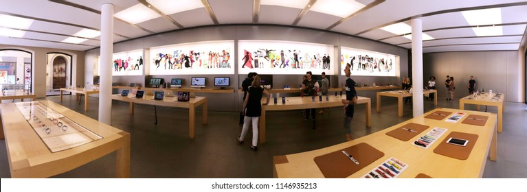 BOLOGNA, ITALY - JULY 2018: Clients inside the Apple Store. Panoramic image.