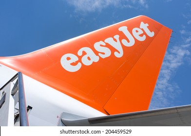 BOLOGNA, ITALY - JUNE 19, 2014: EasyJet company logo on the tail of a boeing.