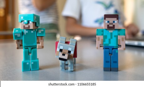BOLOGNA, ITALY - JUNE 5, 2018: Minecraft toy minifigures at home. Minecraft is a video game created by game designer Markus Persson, better known as Notch. Illustrative editorial.