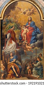 BOLOGNA, ITALY - MARCH 15, 2014: Madonna in the glory with the st. Ignace, angels and saints by D. Creti (1736) in Dom - Saint Peters baroque church.