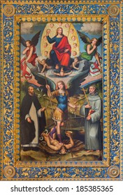 BOLOGNA, ITALY - MARCH 16, 2014 The Archangel Michael and st. Dominic and st. Francis and Jesus the Pantokrator in church Chiesa di San Domneico - Saint Dominic by Giacomo Francia (1486 - 1557).
