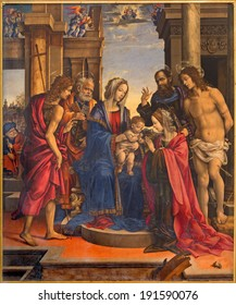 BOLOGNA, ITALY - MARCH 16, 2014: Madonna and saints Peter, Paul, John the Baptist, Katherina and Sebastian by Filippino Lippi (1501) in church Chiesa di San Domneico - Saint Dominic church.