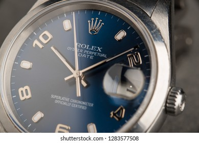 BOLOGNA, ITALY - MARCH 5, 2018: Rolex Oyster Perpetual Date watch. Rolex SA is a Swiss luxury watchmaker, founded by Hans Wilsdorf and Alfred Davis in London, England in 1905. Illustrative editorial.