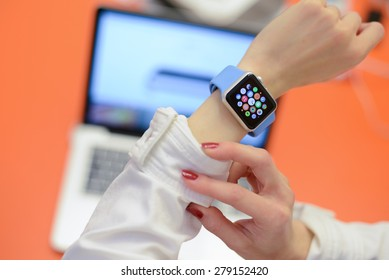BOLOGNA, ITALY - MAY 17, 2015: the Apple Watch against a blurred laptop in an office environment