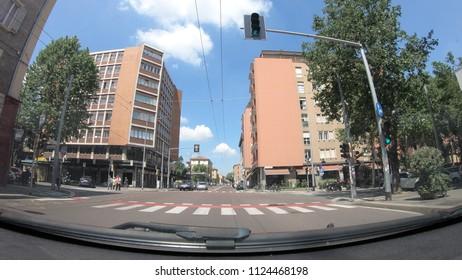 Bologna, Italy - May 19, 2018: POV driving to Bologna downtown city center along the historic Viale Giuseppe Mazzini street.