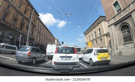 Bologna, Italy - May 19, 2018: POV driving to Bologna downtown along the Porrettana avenue, passing by historic Bologna train station.
