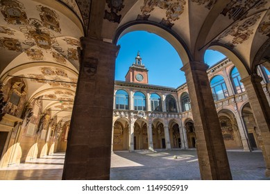 BOLOGNA, ITALY - MAY, 2018: The Archiginnasio atrium. It houses now the Municipal Library and the famous Anatomical Theatre.