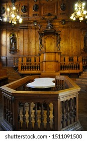 Bologna, Italy -May 25, 2011 : old dissection table in the Anatomical Theatre of the Archiginnasio at University of Bologna medical school with Carved sculptures of physicians, teacher's chair