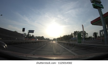 Bologna, Italy - May 27, 2018: POV point of view of car driving on Bologna city on broad avenue Nuova Bazzanese and Viale Sandro Pertini state highway. Italian street traffic on Sunday