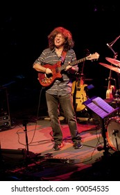 """BOLOGNA, ITALY - NOV 12: """"Pat Metheny"""" [Jazz Guitarist] playing wood acoustic guitar  near the battery at Bologna Jazz Festival in Bologna, Italy on Nov 12, 2011."""
