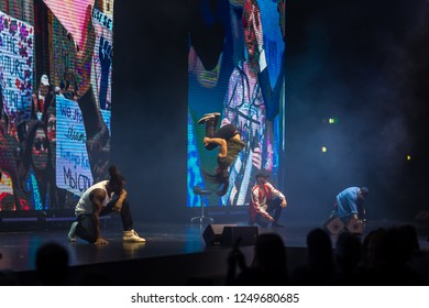 BOLOGNA, ITALY - NOVEMBER 25, 2018: Breakdancers perform on catwalk in theatre during hairstyle show of ALFAPARF  at ON HAIR SHOW