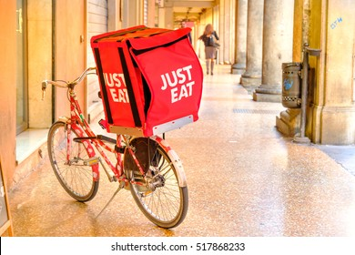 Bologna, italy, oct 16 2016: a JUST EAT container on a bike used for the deliveries under the Bologna's porticos. JUST EAT is a online food order and delivery service based in UK.