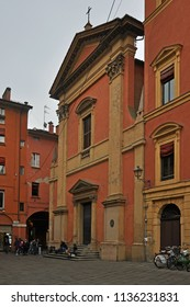 BOLOGNA, ITALY – OCTOBER 11, 2016: people sitting  in front of Saint John the Baptist of the Celestines church. The place is part of the medieval city.