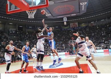 Bologna, Italy, October 13 2019 Isaac Fotu , De´ Longhi Treviso, on shot thwarted from  Ed Daniel , Fortitudo Pompea Bologna,   during Fortitudo Bologna vs De Longhi Treviso Basket Italian Basketbal
