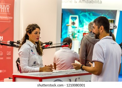 BOLOGNA, ITALY -  OCTOBER 17, 2018: Booth presenters welcoming visitors. The fifty-third edition of the fair hopes to exceed the 52,453 visitors of the 2016.