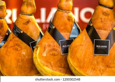 BOLOGNA, ITALY - OCTOBER 2, 2018: lights are enlightening hanging Ruliano Parma hams signed by Heinz Beck at FICO EATALY WORLD, the largest agri-food park in the world