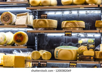 BOLOGNA, ITALY - OCTOBER 2, 2018: lights are enlightening wheels of cheese fo sale at FICO EATALY WORLD, the largest agri-food park in the world