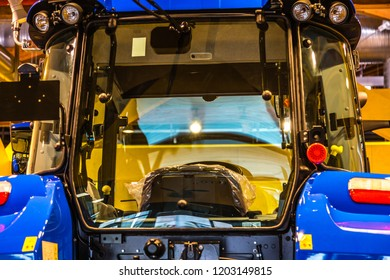BOLOGNA, ITALY - OCTOBER 2, 2018: lights are enlightening New Holland tractor at FICO EATALY WORLD, the largest agri-food park in the world
