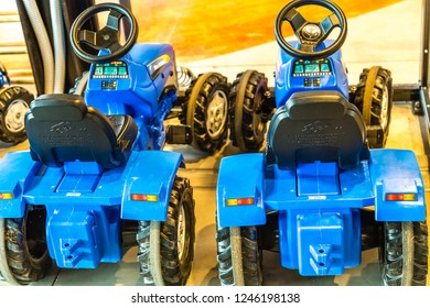 BOLOGNA, ITALY - OCTOBER 2, 2018: lights are enlightening toy tractors at FICO EATALY WORLD, the largest agri-food park in the world