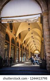 BOLOGNA, ITALY - October 2018: Cozy outdoor restaurant in Old town of Bologna, Italy. Bologna porticos.