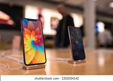 BOLOGNA, ITALY - OCTOBER, 2018: New iPhones Xs and Xs Max in Apple Store with customers blurred in the background.