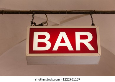 Bologna, Italy - OCTOBER 27, 2018: Bar sign hanging from the ceiling in the street