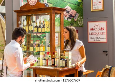 BOLOGNA (ITALY), SEPTEMBER 10, 2018:  Visitor is visiting a stand and asking exhibitor about the products at SANA, international exhibition of organic and natural products