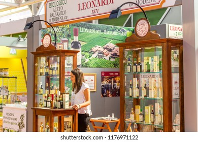 BOLOGNA (ITALY), SEPTEMBER 10, 2018: Booth presenter awaiting visitors to give information about the products at SANA, international exhibition of organic and natural products