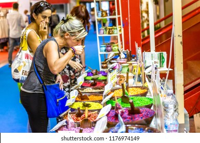 BOLOGNA (ITALY), SEPTEMBER 10, 2018: visitors are smelling scented quartz at SANA, international exhibition of organic and natural products