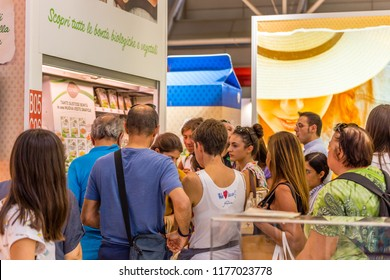 BOLOGNA (ITALY), SEPTEMBER 10, 2018: booth presenter is cooking food for tasting for visitors at SANA, international exhibition of organic and natural products