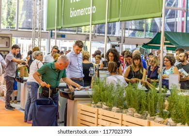 BOLOGNA (ITALY), SEPTEMBER 10, 2018: visitors buying food and cosmetics and paying at the checkout at SANA, international exhibition of organic and natural products