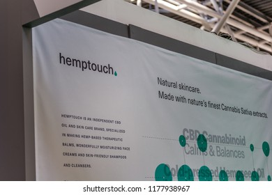 BOLOGNA (ITALY), SEPTEMBER 10, 2018: light enlightening board with logo of HEMPTOUCH at SANA, international exhibition of organic and natural products