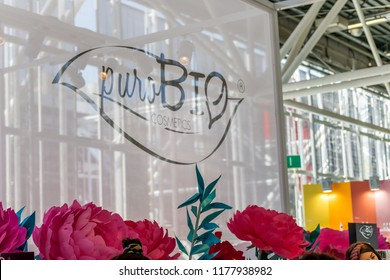 BOLOGNA (ITALY), SEPTEMBER 10, 2018: light enlightening board with logo of puroBIO COSMETICS at SANA, international exhibition of organic and natural products