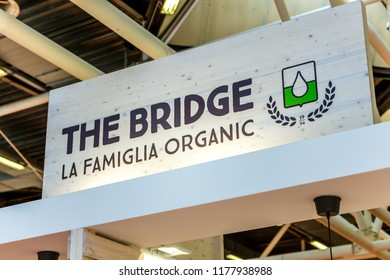 BOLOGNA (ITALY), SEPTEMBER 10, 2018: light enlightening board with logo of THE BRIDGE at SANA, international exhibition of organic and natural products