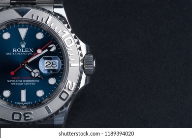 BOLOGNA, ITALY - SEPTEMBER, 2018: Rolex Oyster Perpetual Date Yacht Master watch on dark background. Rolex SA is a Swiss luxury watchmaker, founded in London, England in 1905. Illustrative editorial.
