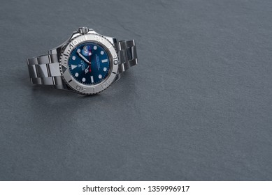 BOLOGNA, ITALY - SEPTEMBER, 2018: Rolex Oyster Perpetual Date Yacht Master watch on grey background. Rolex SA is a Swiss luxury watchmaker, founded in London, England in 1905. Illustrative editorial.