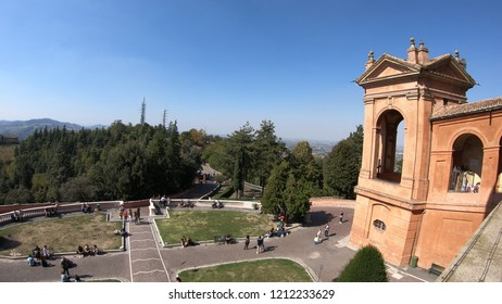 Bologna, Italy - September 29, 2018: top view of courtyard of Madonna of San Luca Sanctuary on Bologna hills with international tourists.