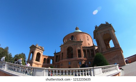 Bologna, Italy - September 29, 2018: panorama of the courtyard of Madonna of San Luca Sanctuary on Bologna hills with international tourists on holiday.
