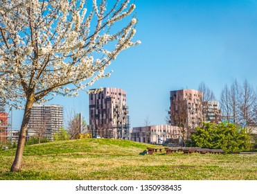 Bologna Quartiere Navile in Italy with Trilogia Navile modern building city park in spring .