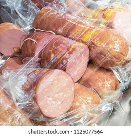 bologna sausages in refrigerator