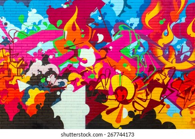 BOLOGNA,ITALY - MARCH 12, 2015: Street art by unidentified artist. Enlivened by murals,  painted figures, graffiti and stencils
