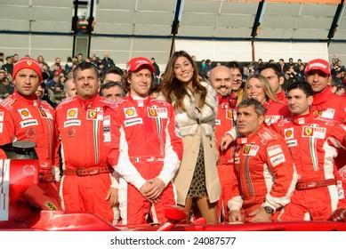 BOLOGNA,ITALY-06 DECEMBER 2008: Ferrari racing team , ferrari pilot and the beautiful argentinian Belen rodriguez, venue of the event, pose for the photographer, Bologna Italy