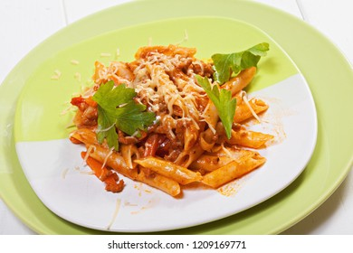 Bolognese pasta over white wooden board. Closeup horizontal shot