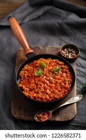Bolognese sauce on rustic board