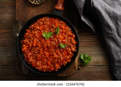 Bolognese sauce in pan top view