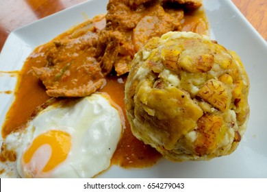 Bolon de verde with fried eggs and meat stew ecuadorian food galapagos