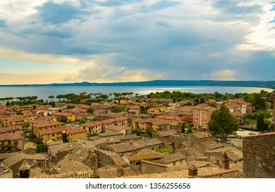 Bolsena, Provincia di Viterbo, Italy. Top view of the roof and the lake.